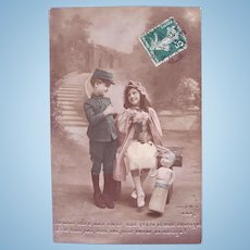 Tinted French Real Photo Postcard, Children and Doll, WWI, Postmarked 1916