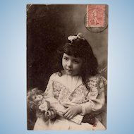 Girl and Doll, French Real Photo Postcard, Postmarked 1905