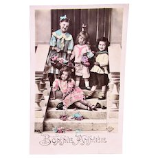French Tinted Real Photo Postcard, Girls and Boys with Flowers, Postmarked 1910