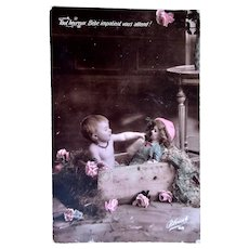 French Tinted Real Photo Postcard, Tiny Girl Feeding Doll, Bleuet, Dated 1907