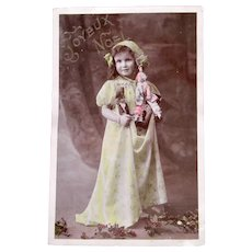 Tinted French Real Photo Postcard, Dolls, Girl and Holly, Postmarked 1908