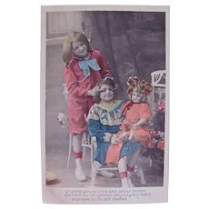 Tinted French Real Photo Post Card, Boy, Girl and Gorgeous Bisque Doll, Postmarked 1909