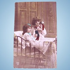 Tinted French Real Photo Postcard, Soldier and Nurse Dolls, Children, Circa 1910s