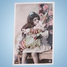 Tinted French Real Photo Postcard, Girl Kissing Punch Doll, Circa 1910s
