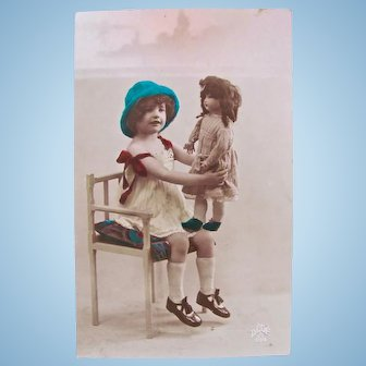 French Tinted Real Photo Postcard, Big Doll, Little Girl, Circa 1920s