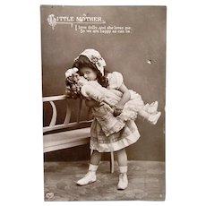 Little Mother, British Real Photo Postcard, Little Girl Kissing Doll, Postmarked 1912