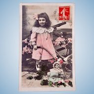 Girl, Doll & Flowers, Tinted French Real Photo Postcard, Postmarked 1909