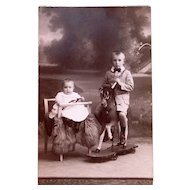 Dutch Real Photo Postcard, Baby, Doll, Boy On Wheeled Horse, Early 20th Century