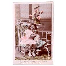 Girl Hugging Doll, Tinted French Real Photo Postcard, Circa 1910s