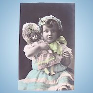 French Hand Tinted Real Photo Postcard, Girl and Doll Wearing Bonnets, Vintage Early 1900s
