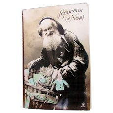 Tinted French Real Photo Postcard, Father Christmas, Dolls and Toys, Heureux Noël, Postmarked 1912