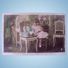 Tinted French Real Photo Postcard, Madame Bébé Teaches Her Doll, Circa 1910s
