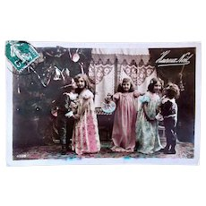 Tinted French Real Photo Postcard, Christmas Kisses, Children & Doll, Postmarked 1909