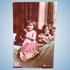 Tinted French Real Photo Postcard, Puppy, Girls and Baby Doll, Circa 1910s