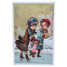 French Chromo Litho Trade Card, 2 Girls Teaching Doll How To Ice-Skate