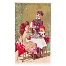 French Chromo Litho Trade Card, Girl and Doll At Cafe, Breakfast, Chocolat Guerin-Boutron
