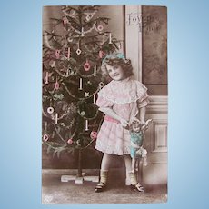 French Tinted Real Photo Postcard, Little Girl, Doll and Decorated Christmas Tree, Postmarked 1912
