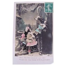 Hand Tinted French Real Photo Postcard, Santa, Doll and Girl, Heureux Noël, Postmarked 1910