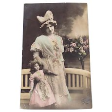 French Hand Tinted Real Photo Postcard, Doll, Woman and Lilacs, Postmarked 1914