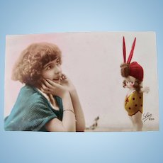 Tinted French Real Photo Postcard, Girl and Kewpie-type Doll, Circa 1920s