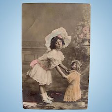 Tinted German Real Photo Postcard, Dancing Girl and Doll, Dated 1907