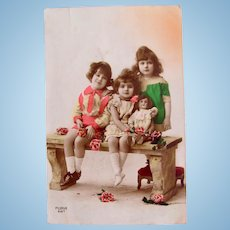 Tinted French Real Photo Postcard, 3 Children and Doll, Dated 1923