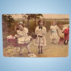 Tinted German Real Photo Postcard, 4 Girls, 3 Dolls, Circa Early 1900s
