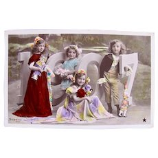 Tinted French Real Photo Postcard, Children and Dolls, Dated 1907