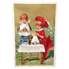 French Chromo Litho Trade Card, 2 Girls Feeding Doll, No Advertising