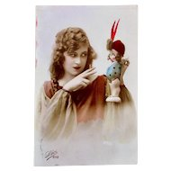French Tinted Real Photo Postcard, Woman with Kewpie Carnival Doll, Circa 1920s