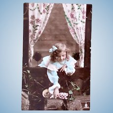 Tinted French Real Photo Postcard, Doll Out The Window, Postmarked 1907