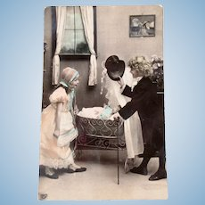 French Tinted Real Photo Postcard, Children and Doll , Postmarked 1910