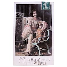 French Tinted Real Photo Postcard, Girl with Doll, My Best Kisses, Circa 1910s