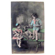 Tinted French Real Photo Postcard, Girl, Boy, Doll and Dog, Circa Early 1900s,