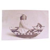 British Real Photo Postcard, Girl and Doll In Boat, Dames at Sea, Circa 1930s