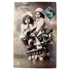 Tinted French Real Photo Postcard, Girl and Boy, Dolls and Toys, Postmarked 1911
