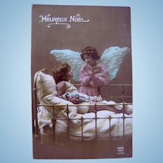 Tinted French Real Photo Postcard, Angel, Child and Doll, Heureux Noël Postmarked 1923