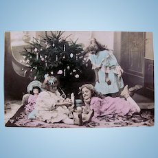 Tinted French Real Photo Postcard, 3 Girls, Doll and Christmas Tree, Postmarked 1908