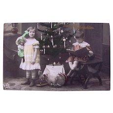 Tinted German Real Photo Postcard, Girl, Boy, Doll and Toys, Circa 1910s