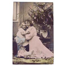 Tinted French Real Photo Postcard, 2 Sisters, Doll, Toys and Tree, Postmarked 1908