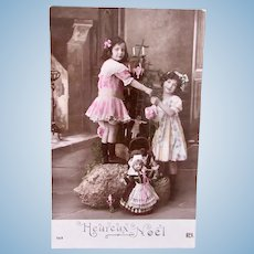 French Tinted Real Photo Postcard, Girls, Dolls and Tree, Circa 1910s