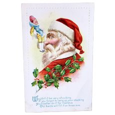 Embossed Christmas Postcard, Santa, Clown Doll and Holly, Postmarked 1918