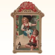Lithograph Die Cut Boy & Girl in Window with Doves