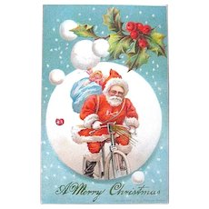 Delightful Antique Bicycle Riding Santa Claus Postcard