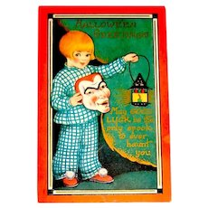 Scarce Whitney Halloween Postcard - Girl Holds Scary Mask