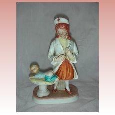 Vintage Nurse Bisque Figurine Figure RN giving Baby a Shot