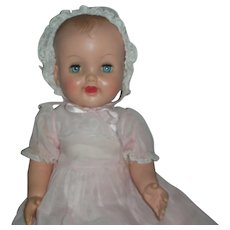 Vintage 1950's Rubber Squeak Baby Doll with Molded Hair and Long pink Organdy Gown Sleep Eyes