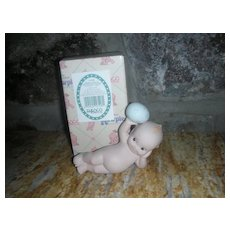 Rose O'Neill Kewpie Collection Action Figurine Doll Laying on Side with Easter Egg