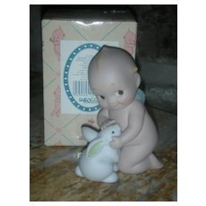 Rose O'Neill Kewpie Collection Action Figurine Doll tumbling Sitting with Easter Bunny