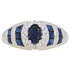 1.60ctw Oval Cut Synthetic Sapphire Ring - 10k Gold Halo-Inspired w/ Diamonds